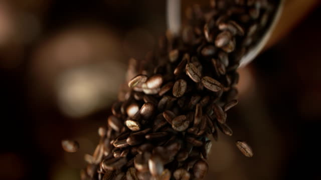Falling coffee beans in super slow motion in 4K