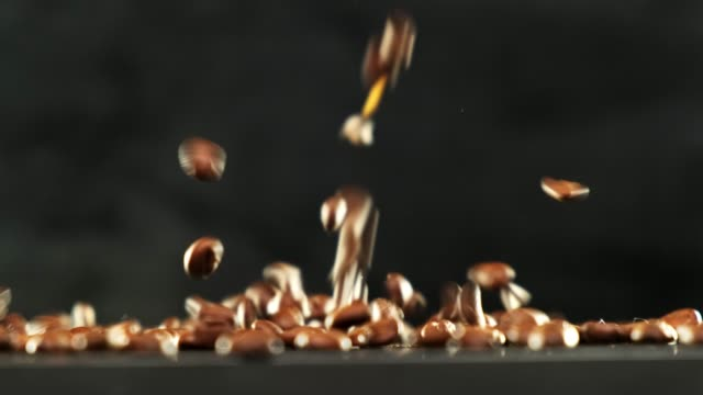 Falling Coffee Beans on black background.