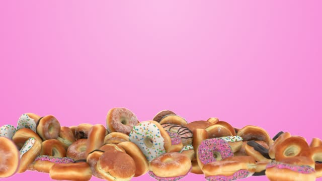 falling different donuts on a pink background - bombolone video stock e b–roll