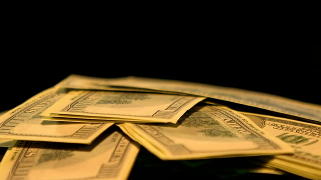 Falling dollar banknotes isolated on black background, bank robbery, crime Falling dollar banknotes isolated on black background, bank robbery, crime human trafficking stock videos & royalty-free footage