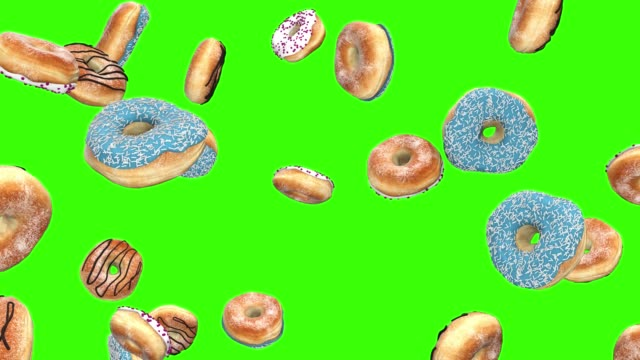 falling donuts on an green screen - bombolone video stock e b–roll
