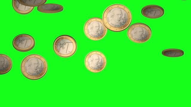 falling euro coins on chroma green bg - simbolo dell'euro video stock e b–roll
