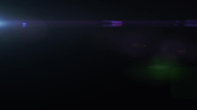 Falling flickering glare in motion on black background HD 1920x1080
