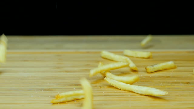 Falling French fries . Close up. Front view. Slow motion. video