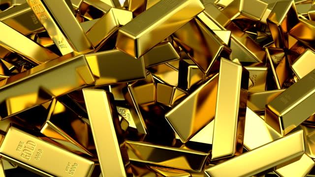 stockvideo's en b-roll-footage met falling gold bars fills the screen - goudstaaf