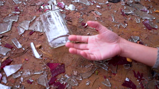Falling Hand with Bottle. death from alcohol video
