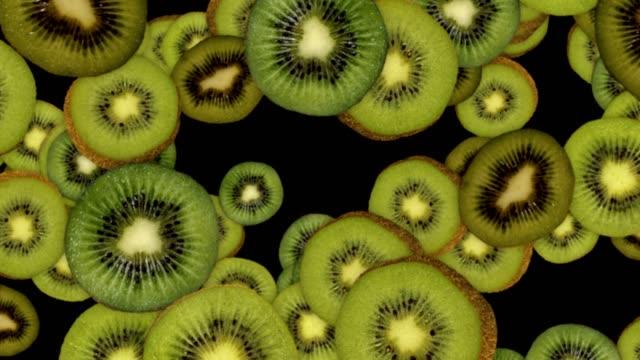 fallande kiwi bakgrund, loop, 60fps, med alfakanal - kiwifrukt bildbanksvideor och videomaterial från bakom kulisserna