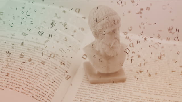 Falling letters and sculpture of ancient head. video