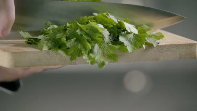 Falling of parsley. Slow motion 240 fps falling of parsley parsley stock videos & royalty-free footage
