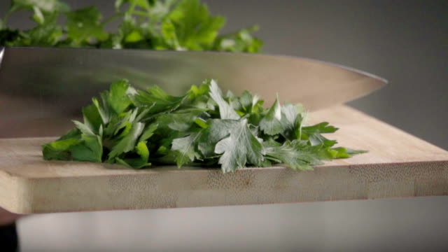 Falling of parsley. Slow motion 480 fps falling of parsley parsley stock videos & royalty-free footage