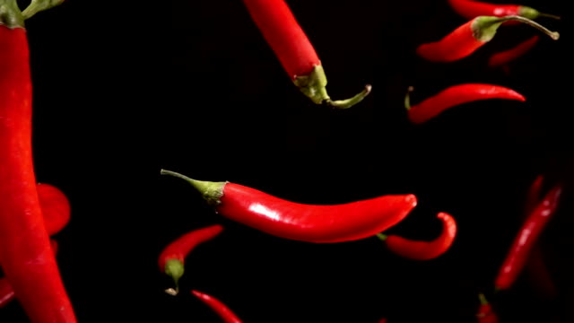 Falling of red pepper. Slow motion 240 fps