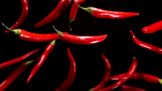 Falling of red pepper. Slow motion 480 fps falling of red pepper chili pepper stock videos & royalty-free footage