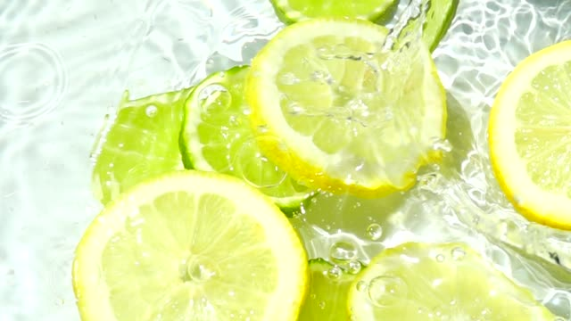 Falling of segments of a lemon and lime. Slow motion. video