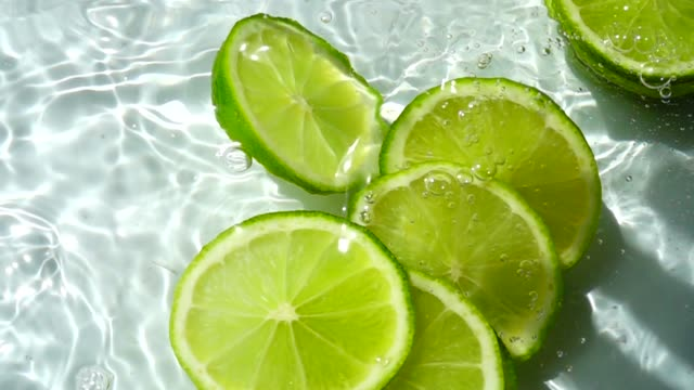 Falling of segments of lime. Slow motion. video