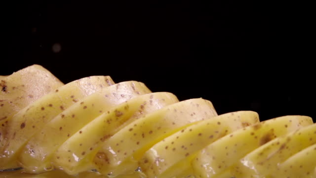 falling of sliced potatoes into the wet table. slow motion 240 fps - молодой картофель стоковые видео и кадры b-roll