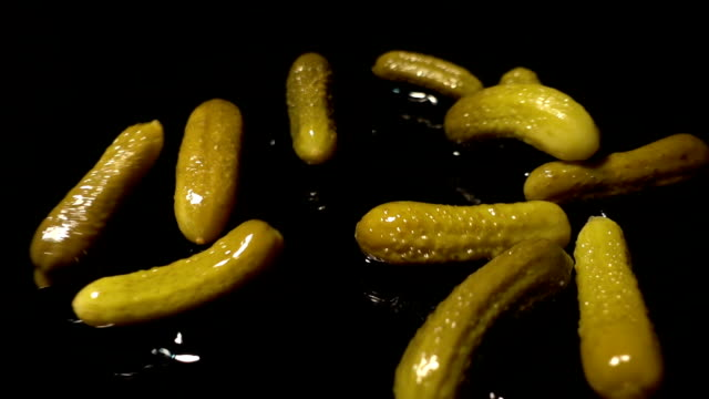 Falling Pickled cucumbers Slowmotion Dolly Shoot - 1080p pickle stock videos & royalty-free footage