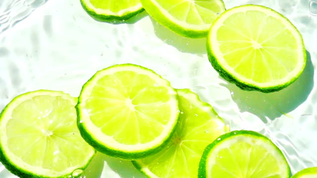 Falling pieces of lime into the water. Slow motion. video
