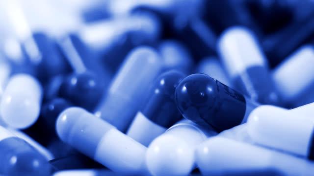 falling pills in blue tone video