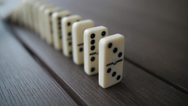 Falling Row of Domino Tiles in Slow Motion