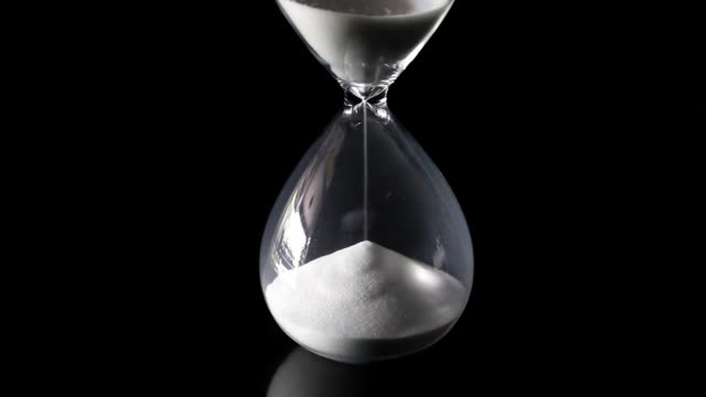 Falling sand showing the passing time of hourglass video