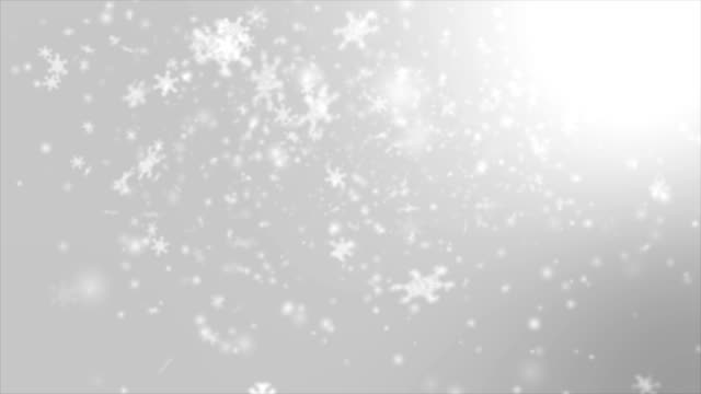 Falling snowflake over gray abstract background for winter promotion and christmas celebration video