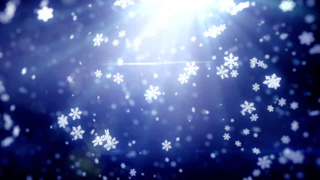 Falling snowflakes background. Loop video