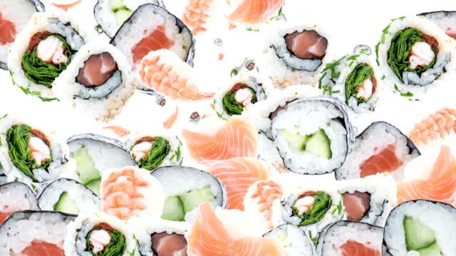 vídeos y material grabado en eventos de stock de caída de sushi como fondo de vídeo (con alfa) - sushi