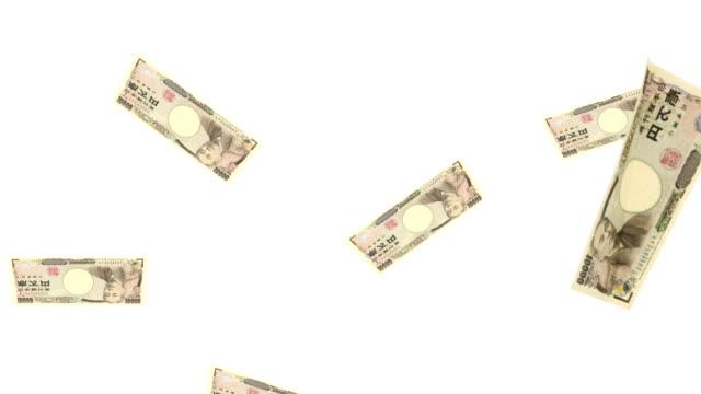 stockvideo's en b-roll-footage met falling ten thousand yen bill as seen from the side - yenteken