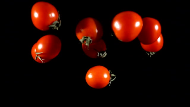 falling tomatoes cherry, slow motion - pomodoro video stock e b–roll