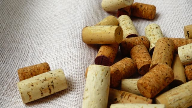 Falling wine corks from wine bottles on the bag. Slow motion. Falling wine corks from wine bottles on the bag. Slow motion. cork stopper stock videos & royalty-free footage