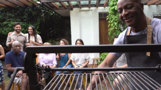 Family and Friends Enjoying a Barbecue Party at Home