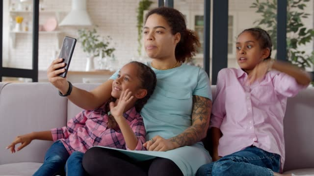 Family and kids making video call online on phone