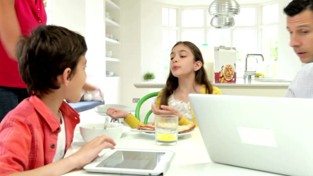 Family Argument Over Digital Devices At Breakfast Table video