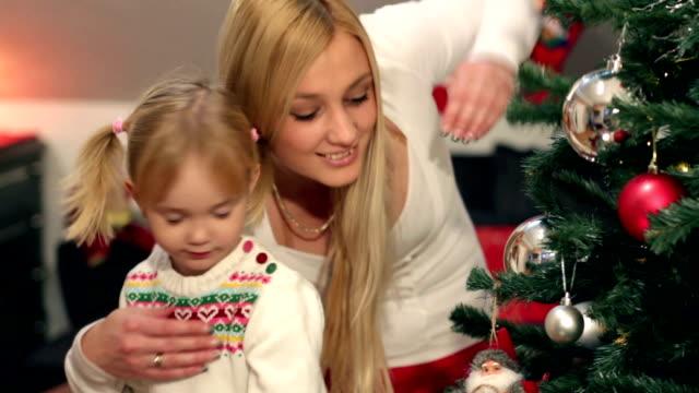 family around christmas tree family around christmas tree blue hair stock videos & royalty-free footage