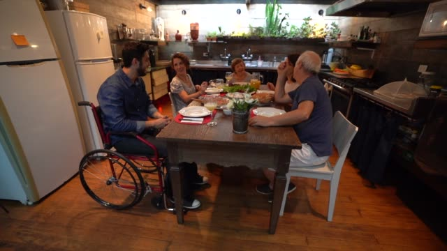 Family at Dinner / Lunch time Family Dinner wheelchair stock videos & royalty-free footage