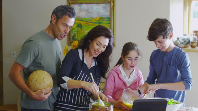 Family at Home Cooking in Kitchen video