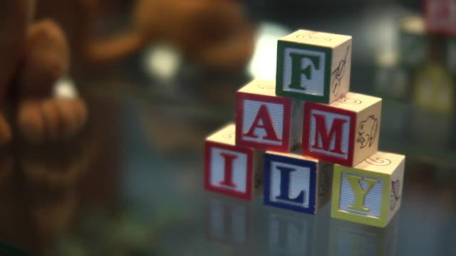 family blocks children's blocks form the word family alphabet stock videos & royalty-free footage