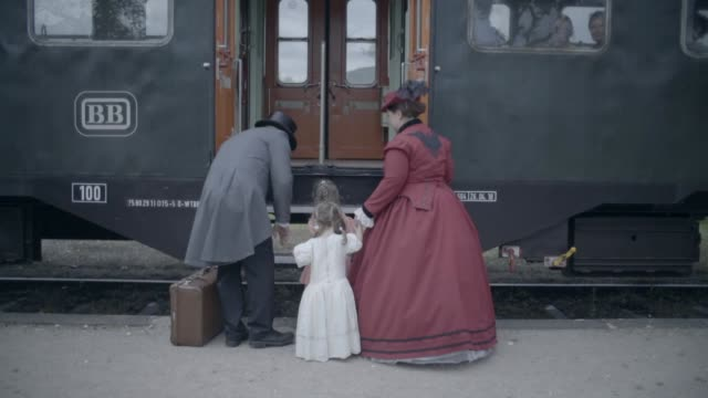 Family boarding old steam train Victorian family visiting old train station 19th century style stock videos & royalty-free footage