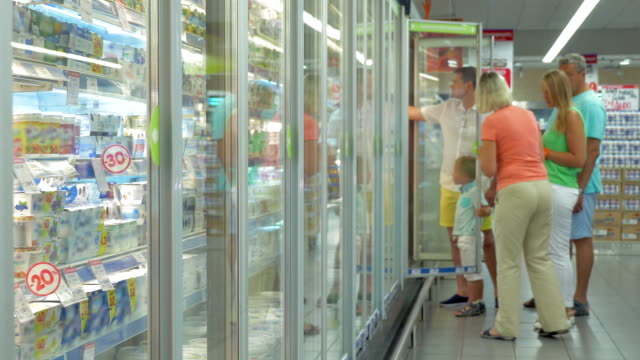 Family by the Refrigerator in the Supermarket video