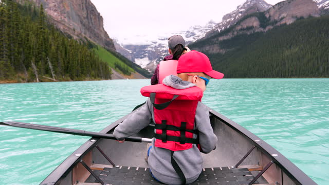 POV Family canoeing at Lake Louise, Alberta in Summer