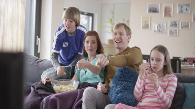 Video Family cheering watching a football match