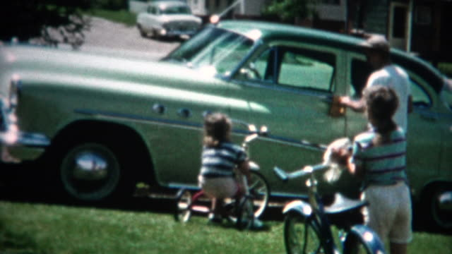 (8mm Film) Family Cleaning Vehicles in Yard 1956