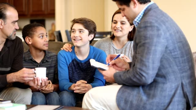 Family counseling session at home with therapist. video