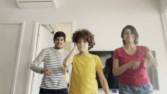 Family dancing and filming it at home - camera point of view video