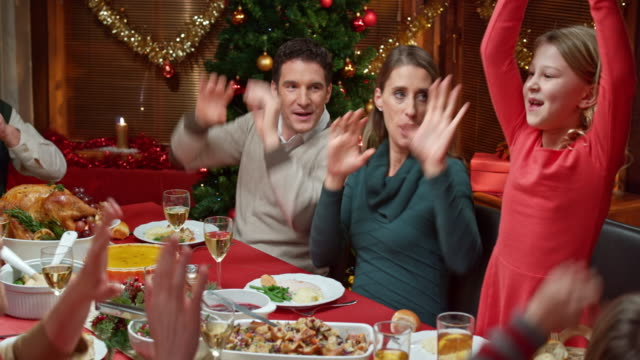 Family doing a funny dance at the Christmas table