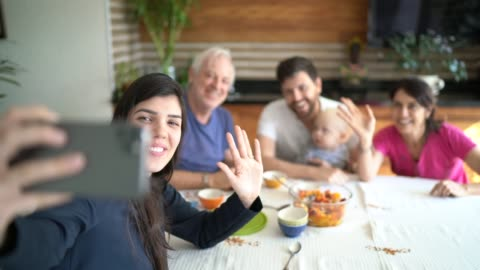Family doing a video chat with mobile phone at home Family doing a video chat with mobile phone at home family stock videos & royalty-free footage
