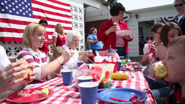 Family eating at 4th of July barbecue  family 4th of july stock videos & royalty-free footage