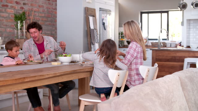 Family Eating Meal In Kitchen Together video
