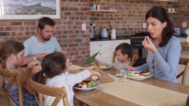 Family Eating Meal In Open Plan Kitchen Together video