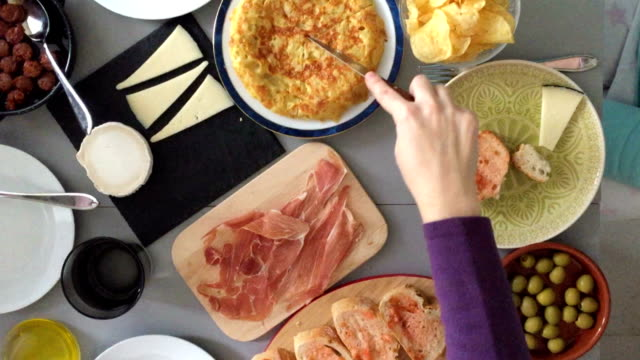 Family eating typical Spanish tapas. video